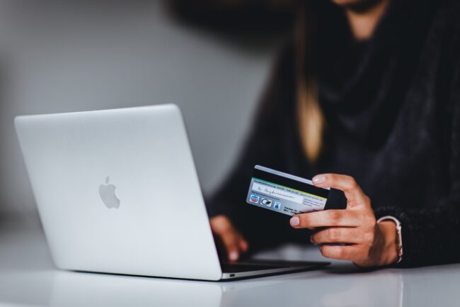 Woman shopping online with bank card